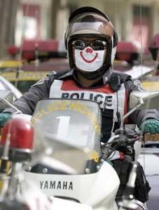 Thai traffic police wearing smiley masks